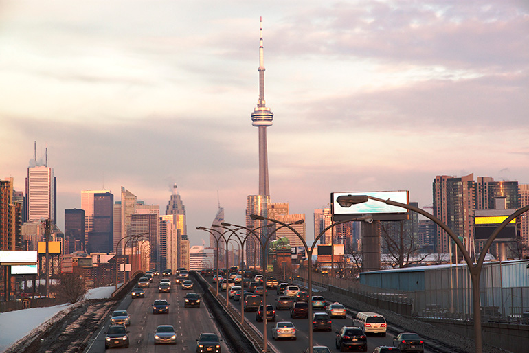 Busy Highway to Toronto Downtown With Skyline
